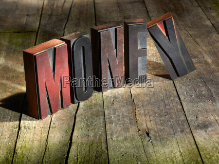 wooden blocks spelling money