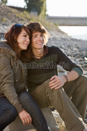 young couple sitting together