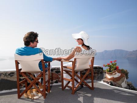 couple sitting on a sundeck