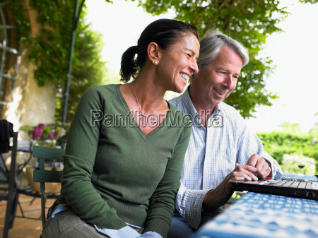 couple on computer laughing