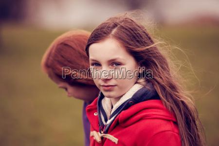 portrait of girl walking with friend