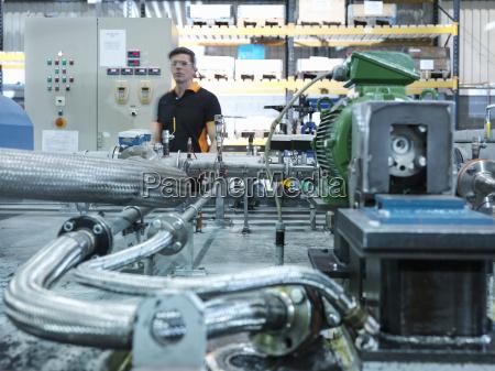 engineer with industrial pump testing rig
