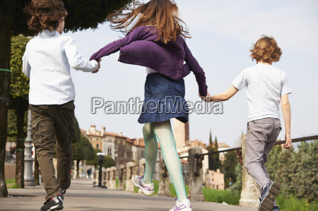 young boys and older sister marching