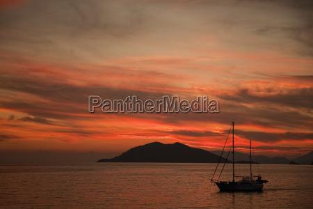 silhouetted boat at sunset fethiye turkey