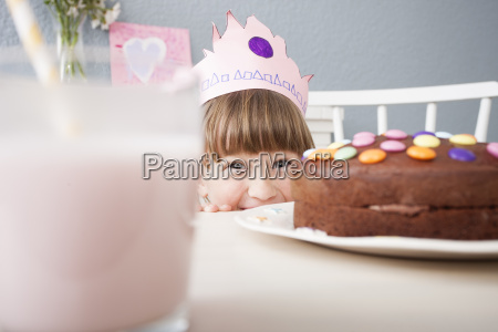 girl hiding behind cake
