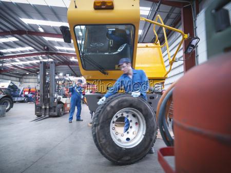 engineers preparing to fix wheel in