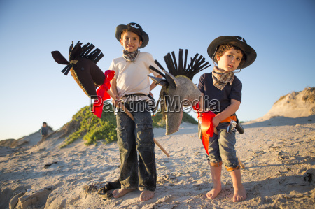 two brothers dressed as cowboys with