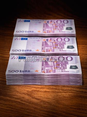 three stacks of 500 euro bills
