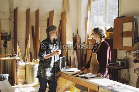 two craftswomen drinking coffee in pipe