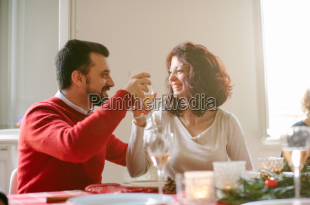 couple toasting at family christmas party