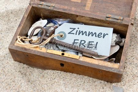 wooden box with shells stones keys
