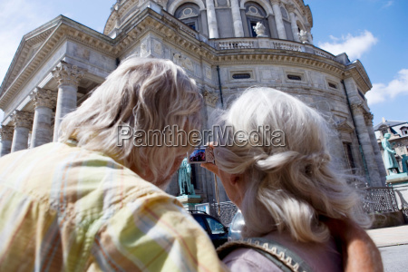 couple taking picture of church