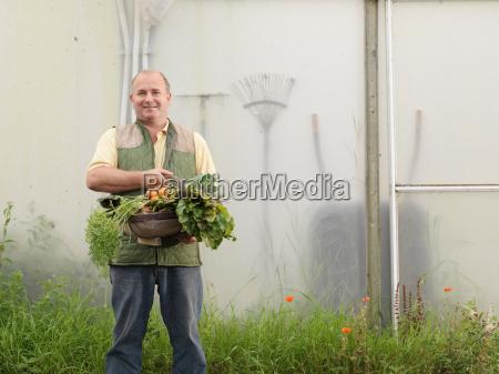 farmer with basket of vegetables