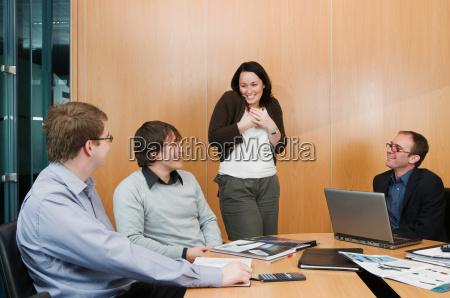 woman talking in office meeting