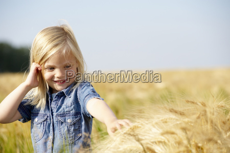 girl caressing the wheat in a