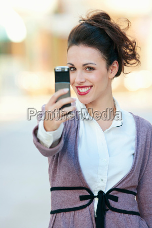 a woman taking a picture on