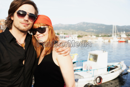 couple in front of harbor