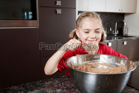 girl eating cake mix from the