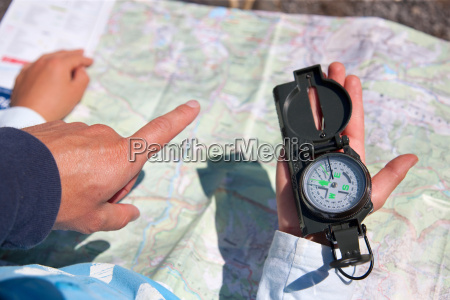 father and son using compass and
