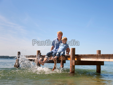 father and son dangling feet in