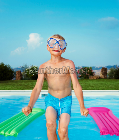 boy in mask jumping into swimming