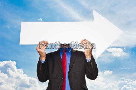 businessman holding blank arrow