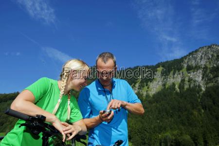 mountain bikers using gps device
