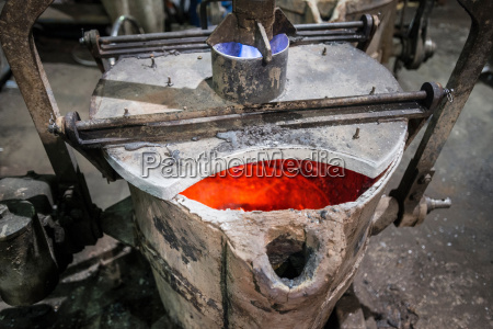 heated industrial metal flask in foundry