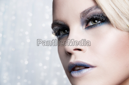 close up of woman against glittery