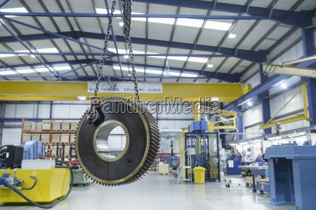 heavy engineering gear hanging from crane