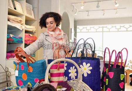young woman browsing shopping bags in