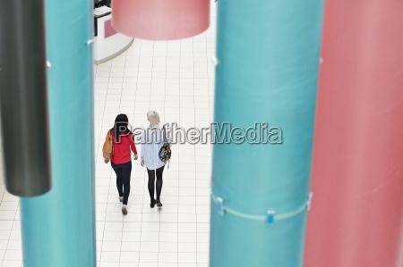 two young women walking high angle
