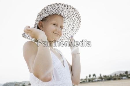 portrait of girl holding her sunhat
