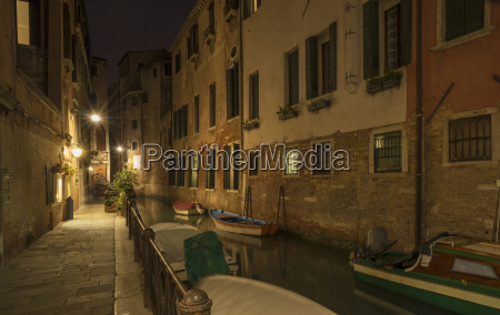 boats on canal at night venice