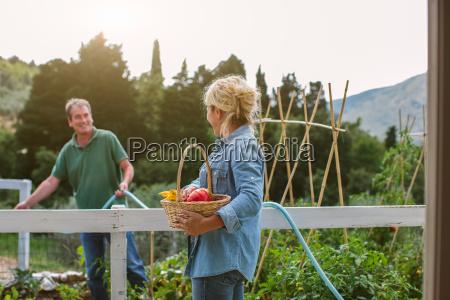 mature woman holding basket of fresh
