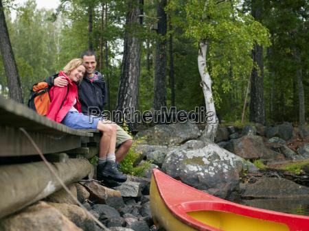 couple sitting on a dock near