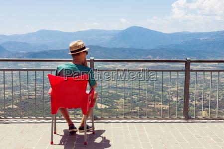 teenager enjoying mountainous landscape