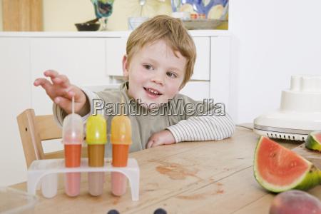 boy making fruit lollies