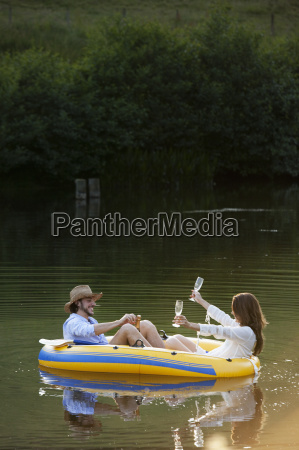 couple in dinghy on a country