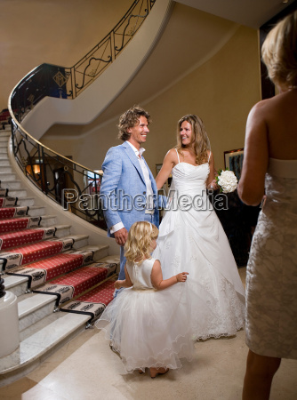 bride and groom descend staircase