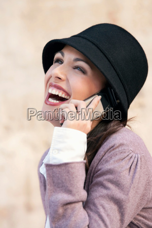 a woman laughing on a mobile