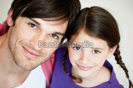 father and girl looking to camera
