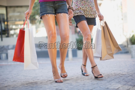 womens legs with shopping bags