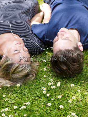 couple listening to headphones together