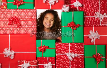 girl smiling in christmas gift fort