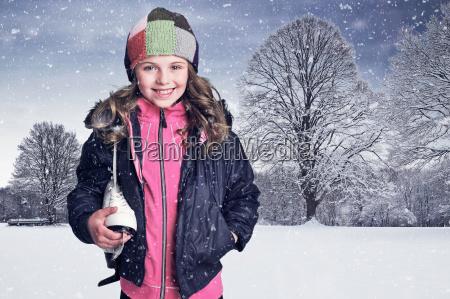 girl carrying sneaker in snow