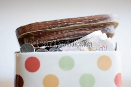 jar full of money on desk