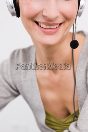 close up woman with headset smiling