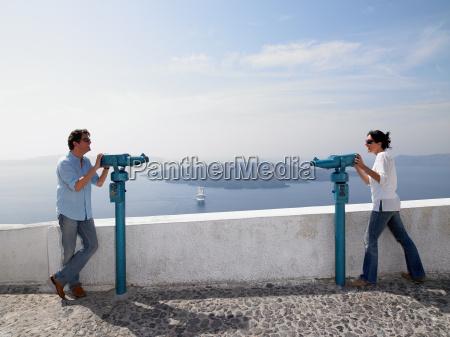 couple looking through spyglasses