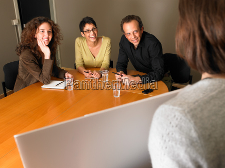 woman giving presentation in meeting